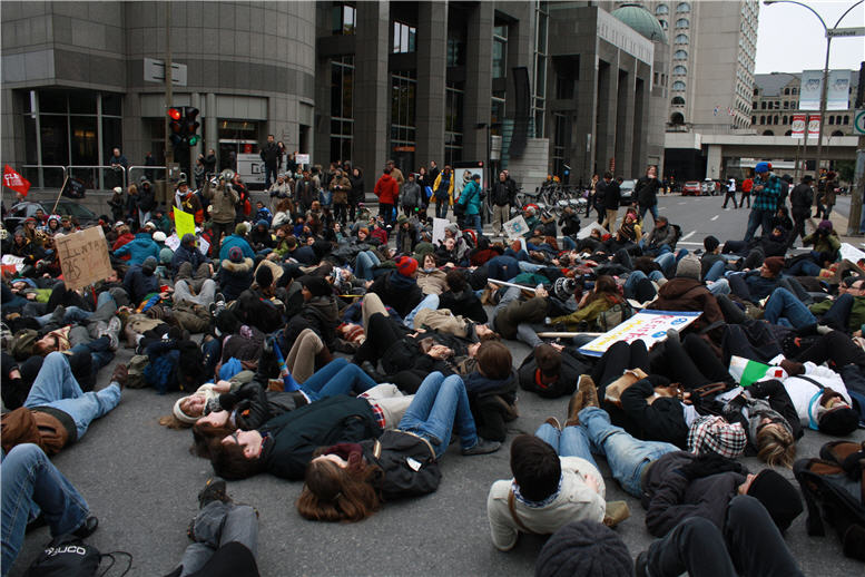 Occupy Montreal march intersection lie-in