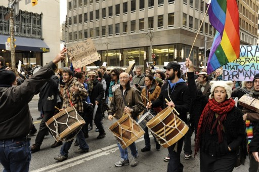 Occupy Toronto marchers drum and chant