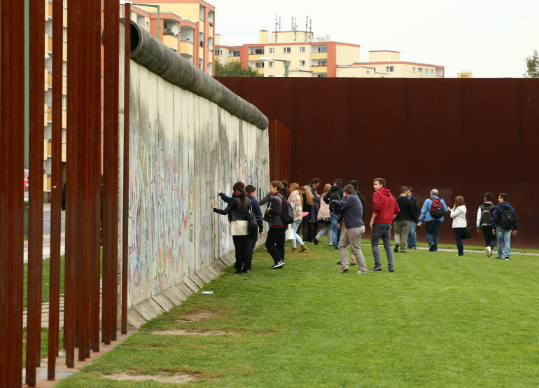 young people visit Berlin Wall memorial