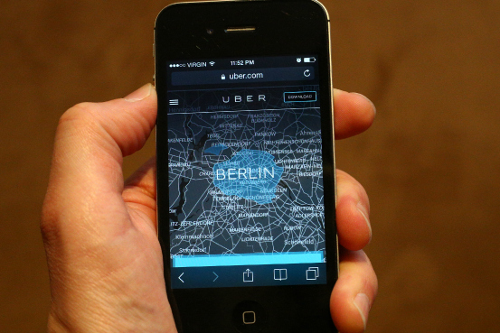 hand holds iphone displaying Uber app