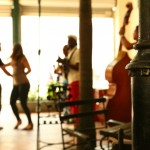 A couple dances to music in a restaurant in Cuba