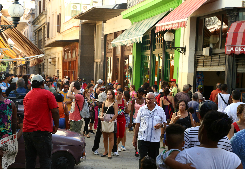 a bustling pedestrian street in Havana