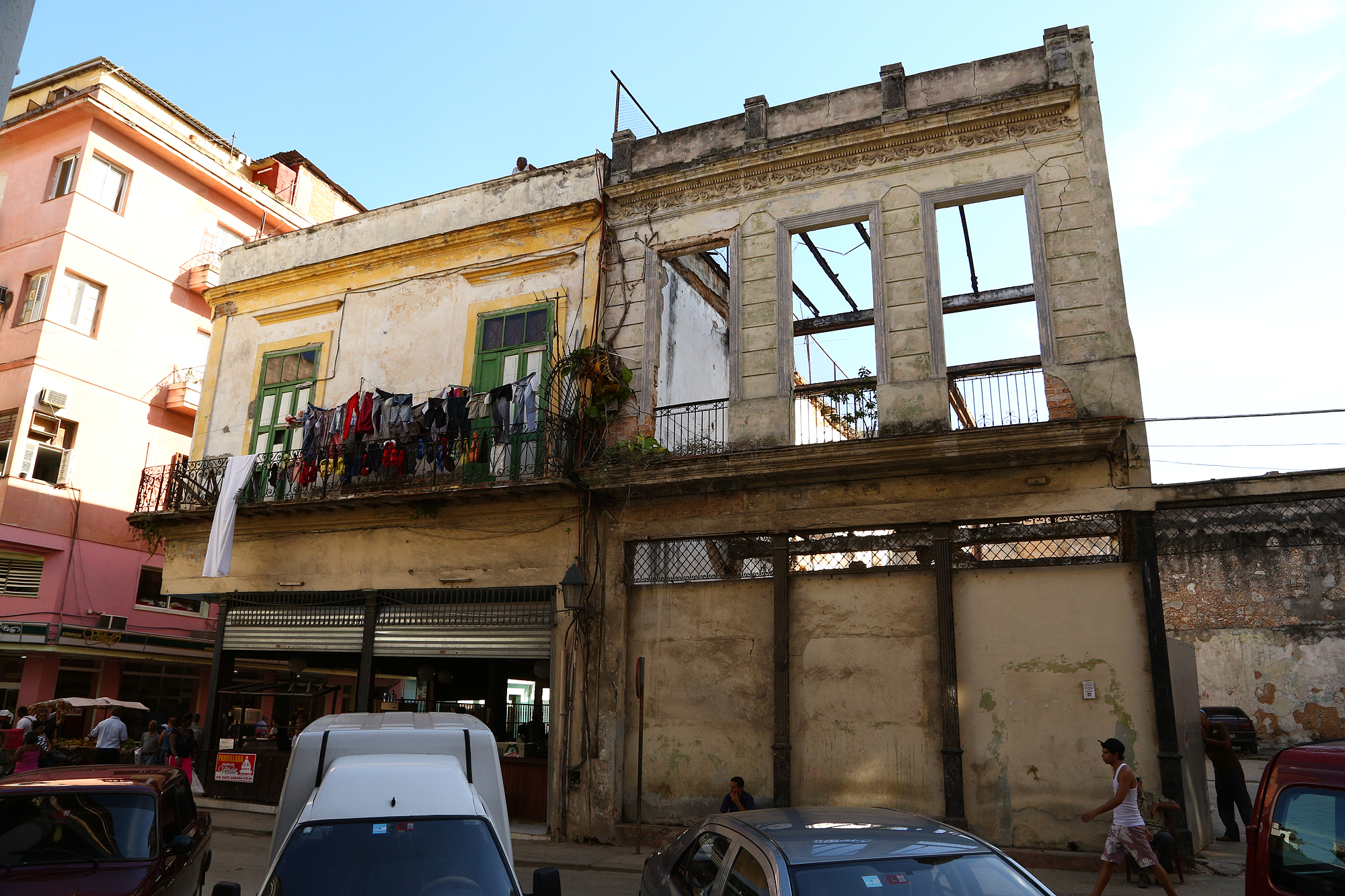 A house facade and skeleton stands in Old Havana