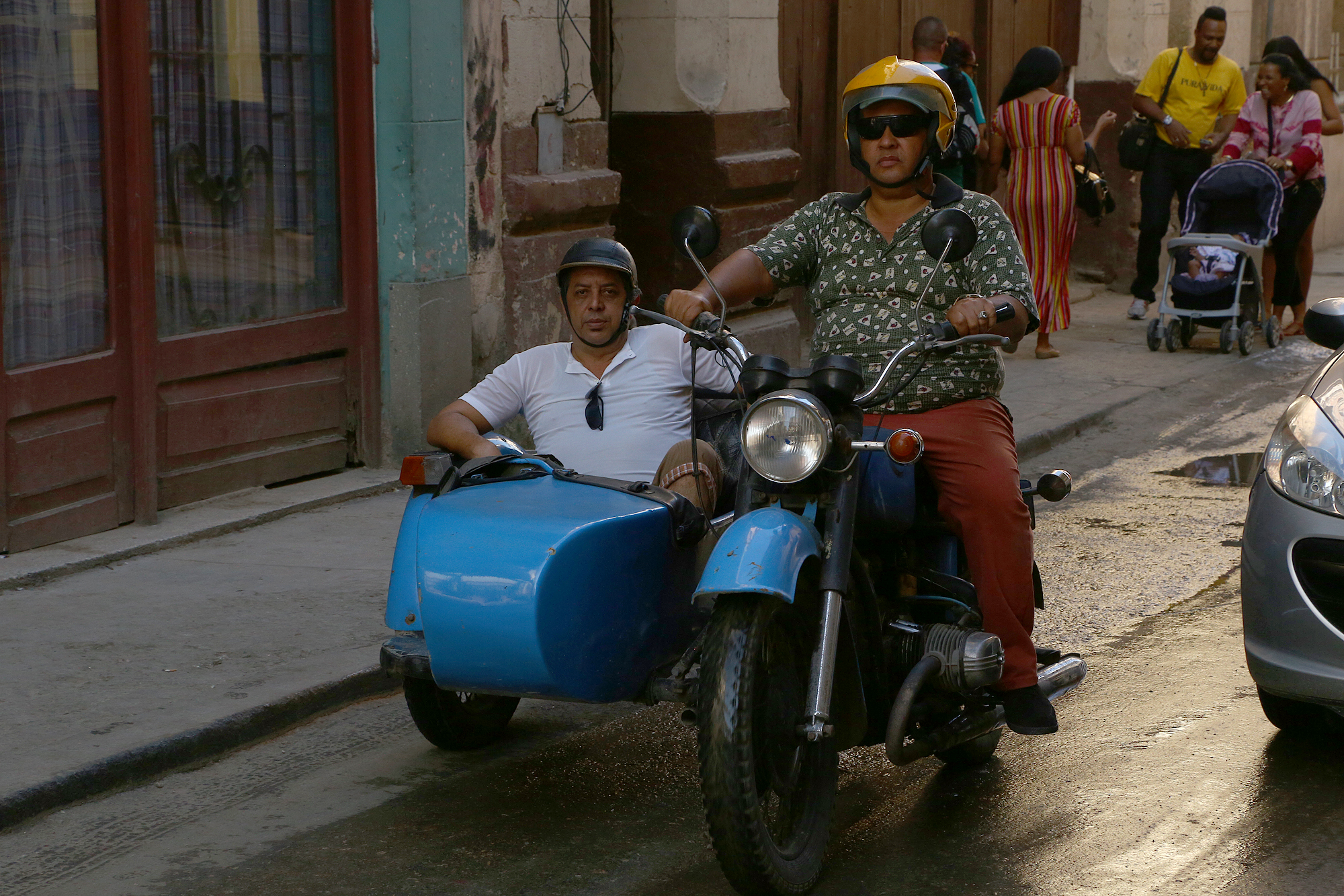 Motorcyclsit and sidecar passenger in Old Havana